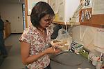 Ramona Examining Black Bear Skull