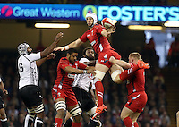 Pictured: Luke Charteris of Wales (C) clumsily passes the ball after a line out. Saturday 15 November 2014<br />