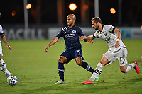 LAKE BUENA VISTA, FL - AUGUST 01: Héber #9 of New York City FC passes away from Dario Zuparic #13 of the Portland Timbers during a game between Portland Timbers and New York City FC at ESPN Wide World of Sports on August 01, 2020 in Lake Buena Vista, Florida.