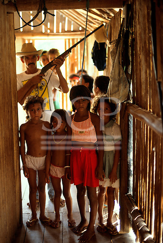 Acre State, Brazil. Large settler family; the father holds a rifle used to defend the family against gunmen.