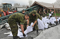 Near Saint-Jean-sur-Richelieu (QC) CANADA - May 2011 file photo ; the Army is called in to help after the flood of land beside the Richelieu river south of Montreal