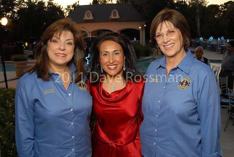 From left: Laura Ward, Amber Thomas and Charlene Floyd at the Second Annual True Blue Gala sponsored by the Houston Police Foundation at the home of Paige and Tilman Fertitta Saturday Oct. 17,2009. (Dave Rossman/For the Chronicle)