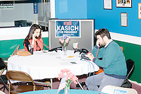 "Amos Rothstein (right), Rhode Island state director of the Kasich campaign, and Miss Rhode Island 2015 Alexandra Curtis, volunteering for the campaign, make ""get out the vote"" phone calls from the campaign headquarters of mayor Scott Avedisian at the Airport Plaza strip mall in Warwick, Rhode Island, on Sun., Apr. 24, 2016. The campaign of Republican presidential candidate John Kasich has set up their state operations in the office. The Cruz and Trump campaigns also opened their state offices in the strip mall."