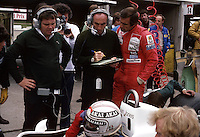 13.07.1980  Chief engineer Patrick Head (l), Team chief Frank Williams (England) chat with driver Carlos Reutemann (Argentinia) and Alan Jones (Australia and Williams Ford) at the Formula 1 Grand Prix of Great Britan 1980 held at Brands Hatch