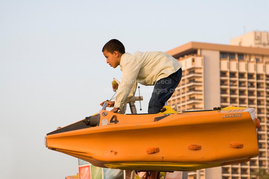 Tripoli, Libya, North Africa - Libyan Boy Standing in Amusement Park Ride.