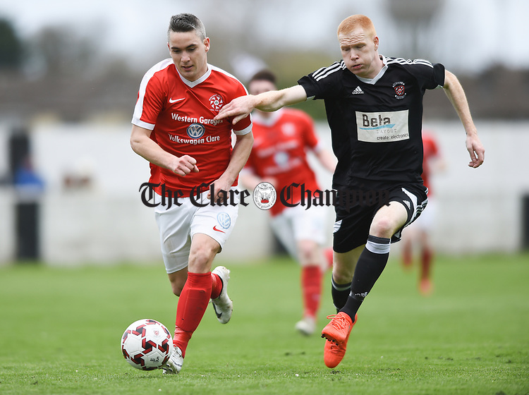 Eoin Hayes of Newmarket Celtic in action against Adrian Power of Janesboro during their Munster Junior Cup semi-final at Limerick. Photograph by John Kelly.