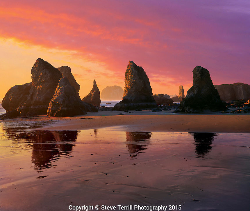 Sunset over rock pinnacles and beach at Bandon Beach Oregon