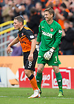 Dundee United v St Johnstone...27.09.14  SPFL<br /> John Rankin congratulates Radoslaw Cierzniak after his quick release led to the first goal<br /> Picture by Graeme Hart.<br /> Copyright Perthshire Picture Agency<br /> Tel: 01738 623350  Mobile: 07990 594431