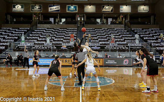 SIOUX FALLS, SD - MARCH 6: Josie Filer #25 of the Omaha Mavericks jumps the opening tip against Paiton Burckhard #33 of the South Dakota State Jackrabbits during the Summit League Basketball Tournament at the Sanford Pentagon in Sioux Falls, SD. (Photo by Dave Eggen/Inertia)