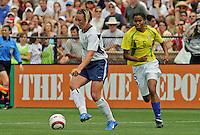 Abby Wambach(USA) v Renata Costa (Bra).US Women's National Team vs Brazil at Legion Field in Birmingham, Alabama.