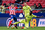 Angel Correa (L) of Atletico de Madrid competes for the ball with Amath Ndiaye Diedhiou of Getafe CF during the La Liga 2017-18 match between Atletico de Madrid and Getafe CF at Wanda Metropolitano on January 06 2018 in Madrid, Spain. Photo by Diego Gonzalez / Power Sport Images