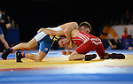 Wales Craig Pilling in action against Scotland's Ross McFarlane<br /> <br /> Photographer Ian Cook/Sportingwales<br /> <br /> 20th Commonwealth Games -Wrestling -  Day 6 - Tuesday 29th July 2014 - Glasgow - UK