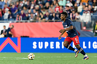 FOXBOROUGH, MA - SEPTEMBER 11: Wilfrid Kaptoum #5 of New England Revolution brings the ball forward during a game between New York City FC and New England Revolution at Gillette Stadium on September 11, 2021 in Foxborough, Massachusetts.