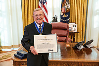 President Trump Presents the Medal of Freedom to Lou Holtz<br /> <br /> President Donald J. Trump presents the Medal of Freedom to Lou Holtz Thursday, Dec. 3, 2020, in the Oval Office of the White House. (Official White House Photo by Tia Dufour)