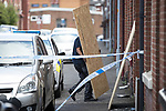 © Joel Goodman - 07973 332324 . 09/07/2017 . Bolton , UK . Windows are boarded up at the scene on Rosamond Street in Daubhill , where a fatal house fire burned through a mid-terrace house yesterday morning (Saturday 8th July 2017) . Anisha Umerji (40) her two sons Hammad (12) and Yusuf (ten) and her daughter Khadija (five) all died in the blaze. Their father Zubair (Anisha's husband) remains in hospital . Photo credit : Joel Goodman