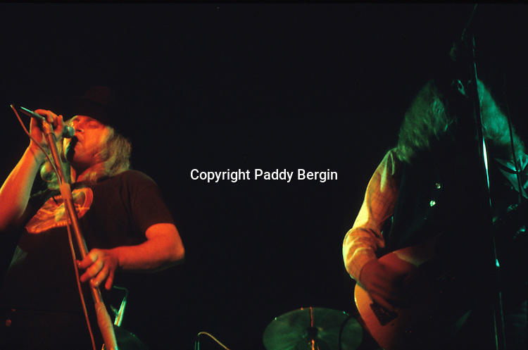 """Ronnie Van Zant and bassist Leon Wilkeson, Lynyrd Skynyrd, Dome Brighton 1974.<br /> <br /> Lynyrd Skynyrd is an American rock band best known for popularising the southern hard-rock genre during the 1970s.<br /> <br /> The band rose to worldwide recognition on the basis of its driving live performances and signature tunes """"Sweet Home Alabama"""" and """"Free Bird"""". At the peak of their success, three members died in an airplane crash in 1977, putting an abrupt end to the band's most popular incarnation.<br /> <br /> Stock Photo by Paddy Bergin"""