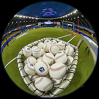 1 April 2016: A basket of Spring Training Baseballs are ready for batting practice prior to a pre-season exhibition game between the Toronto Blue Jays and the Boston Red Sox at Olympic Stadium in Montreal, Quebec, Canada. The Red Sox defeated the Blue Jays 4-2 in the first of two MLB weekend exhibition games, which saw an attendance of 52,682 at the former home on the Montreal Expos. Mandatory Credit: Ed Wolfstein Photo *** RAW (NEF) Image File Available ***
