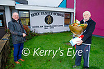 Dave Diggins who retired as caretaker at Holy Family NS in Tralee after 28 years, been presented by Ed O'Brien, principal to mark the occasion.