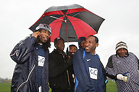 Players of Haggerston Lions FC shelter under an umbrella prior to the kick-off of their East London Sunday League match at Hackney Marshes - 23/11/08 - MANDATORY CREDIT: Gavin Ellis/TGSPHOTO - Self billing applies where appropriate - Tel: 0845 094 6026