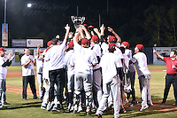 Hickory Crawdads celebrate after game 3 of the South Atlantic League Championship Series between the Asheville Tourists and the Hickory Crawdads on September 17, 2015 in Asheville, North Carolina. The Crawdads defeated the Tourists 5-1 to win the championship. (Tony Farlow/Four Seam Images)