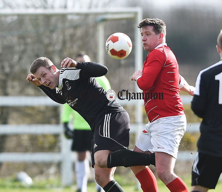 Shane Clarke of Janesboro in action against Paddy Purcell of Newmarket Celtic during their Munster League Champions Trophy final at The County Grounds, Doora. Photograph by John Kelly.
