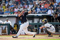 Texas Tech Red Raiders first baseman Cameron Warren (11) follows through on his swing during Game 1 of the NCAA College World Series against the Michigan Wolverines on June 15, 2019 at TD Ameritrade Park in Omaha, Nebraska. Michigan defeated Texas Tech 5-3. (Andrew Woolley/Four Seam Images)