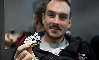 John Degenkolb (DEU/Team Giant-Alpecin) showing an amulet/magnet that a friend bought for him 2 years earlier (ahead of the race) at the San Remo Casino. Dege won the race... and kept the amulet ever since.<br /> <br /> pre-race preparations at the Team Trek-Segafredo bus<br /> <br /> 108th Milano - Sanremo 2017