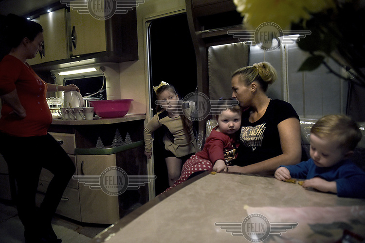 Irish Traveller Viviana Sheridan (9) enters the family's mobile home where her mother Jean is making tea for the family.