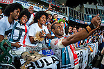 Fiji players celebrate with the trophy on the podium after winning the HSBC Sevens World Cup Final match against New Zealand as part of the Cathay Pacific / HSBC Hong Kong Sevens at the Hong Kong Stadium on 29 March 2015 in Hong Kong, China. Photo by Xaume Olleros / Power Sport Images