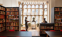 BNPS.co.uk (01202) 558833<br /> Pic: ZacharyCulpin/BNPS<br /> <br /> PICTURED: Museum conservator, Riva Boutylkova (left) and Collections assistant, Kat Broomfield pictured in the stunning newly refurbished library<br /> <br /> An important Roman mosaic that has been saved for the nation went on display today at a county museum.<br /> <br /> The Dorset Museum unveiled the 1,700-year-old panel depicting a leopard attacking an antelope that it acquired earlier this year to stop it from going abroad.<br /> <br /> It forms the centrepiece for the venue which is about to reopen following a £16m transformation that has taken three years.