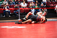 STANFORD, CA - March 7, 2020: Thomas Lane of Cal Poly and J.J. Dixon of Oregon State University during the 2020 Pac-12 Wrestling Championships at Maples Pavilion.