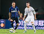 (L) Marco Andreolli of FC Internazionale Milano being followed by (R) Sergio Ramos of Real Madrid CFduring the FC Internazionale Milano vs Real Madrid  as part of the International Champions Cup 2015 at the Tianhe Sports Centre on 27 July 2015 in Guangzhou, China. Photo by Aitor Alcalde / Power Sport Images
