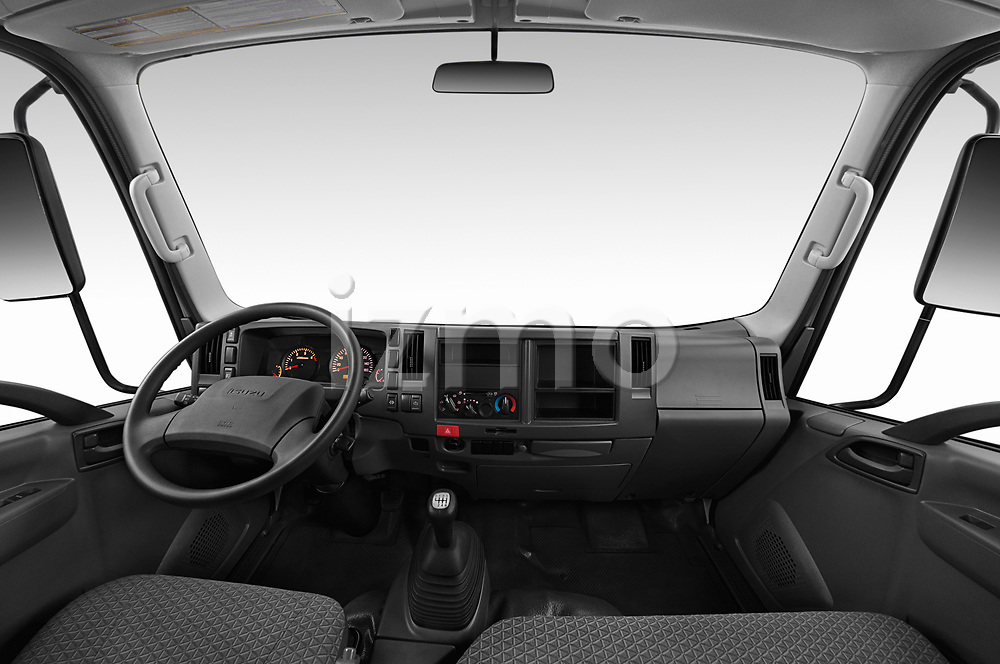 Stock photo of straight dashboard view of a 2019 Isuzu N-Serie Base 2 Door Pick Up