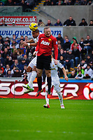 Sunday, 23 November 2012<br /> <br /> Pictured: Wayne Rooney of Manchester United and Ashley Williams of Swansea City<br /> <br /> Re: Barclays Premier League, Swansea City FC v Manchester United at the Liberty Stadium, south Wales.