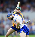 Gavin Corbett of Waterford  in action against Jack Enright of Clare during their Munster  championship round robin game at Cusack Park Photograph by John Kelly.