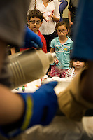 Children watch as Materials Science and Engineering students make ice cream using liquid nitrogen during the MIT Under the Dome open house in Cambridge, Massachusetts, USA.