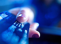 Close up of female's hands holding a credit card