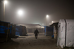 "© Joel Goodman - 07973 332324 . 23/10/2016 . Calais , France . Dawn at the Calais migrant camp known as "" The Jungle "" , in Northern France , on the final day before the eviction and destruction of the camp . Photo credit : Joel Goodman"