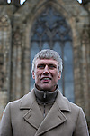 © Joel Goodman - 07973 332324 .  12/01/2015 . Salford , UK . BEZ ( Mark Berry ) launches his parliamentary campaign for the constituency of Salford and Eccles at a poster site on Chapel Street , Salford , in front of Salford Cathedral . Bez , the freaky dancer from Madchester band The Happy Mondays , is standing for The Reality Party . Seat incumbent , Labour's Hazel Blears , is standing down at the 2015 election . Photo credit : Joel Goodman