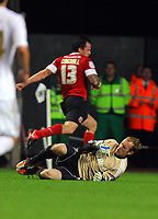 Pictured: Goalkeeper Gerhard Tremmel of Swansea (on the ground) stops Chris Dagnall of Barnsley (13). Tuesday 28 August 2012<br /> Re: Capital One Cup game, Swansea City FC v Barnsley at the Liberty Stadium, south Wales.