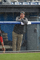Batavia Muckdogs trainer Eric Reigelsberger in the dugout as it rains during a game against the West Virginia Black Bears on June 25, 2017 at Dwyer Stadium in Batavia, New York.  Batavia defeated West Virginia 4-1 in nine innings of a scheduled seven inning game.  (Mike Janes/Four Seam Images)