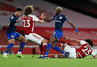 17th December 2020, Emirates Stadium, London, England;  Arsenals Mohamed Elneny and David Luiz challenge for the ball with Southamptons Moussa Djenepo during the English Premier League match between Arsenal and Southampton