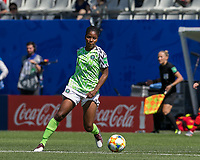 GRENOBLE, FRANCE - JUNE 12: Chinaza Uchendu #11 of the Nigerian National Team controls the ball during a game between Korea Republic and Nigeria at Stade des Alpes on June 12, 2019 in Grenoble, France.