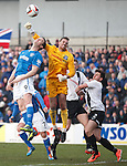 David Hutton punches clear from Rangers striker Jon Daly