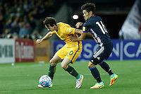 October 11, 2016: ROBBIE KRUSE (10) of Australia and HOTARU YAMAGUCHI (16) of Japan compete for the ball during a 3rd round Group B World Cup 2018 qualification match between Australia and Japan at the Docklands Stadium in Melbourne, Australia. Photo Sydney Low Please visit zumapress.com for editorial licensing. *This image is NOT FOR SALE via this web site.