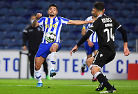 22nd April 2021; Dragao Stadium, Porto, Portugal; Portuguese Championship 2020/2021, FC Porto versus Vitoria de Guimaraes; Jesus Corona of FC Porto stretches to win the loose ball ahead of André Amaro of Guimaraes