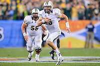 January 01, 2014:<br /> <br /> UCF Knights quarterback Blake Bortles #5 rushes with the ball during Tostitos Fiesta Bowl at University of Phoenix Stadium in Scottsdale, AZ. UCF defeat Baylor 52-42 to claim it's first ever BCS Bowl trophy.