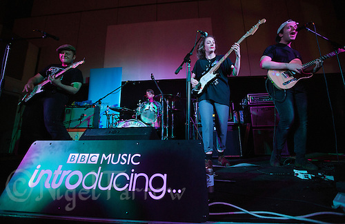 08 APR 2016 - STOWMARKET, GBR - Superglu (from the left) Ben Brown, Ben Ward, Krista Lynch and Alex Brown, perform during a recording for BBC Introducing at the John Peel Centre for Creative Arts in Stowmarket, Suffolk, Great Britain (PHOTO COPYRIGHT © 2016 NIGEL FARROW, ALL RIGHTS RESERVED)
