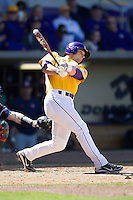 LSU Tigers pinch hitter Tyler Moore #2 follows through on his swing against the Auburn Tigers in the NCAA baseball game on March 24, 2013 at Alex Box Stadium in Baton Rouge, Louisiana. LSU defeated Auburn 5-1. (Andrew Woolley/Four Seam Images).