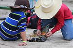 Tristan Bohnam, 5, left, watches his brother Cooper, 8, prepare for competition in the Smackdown at Fuji Park in Carson City, Nev., on Friday, June 5, 2015. <br /> Photo by Cathleen Allison